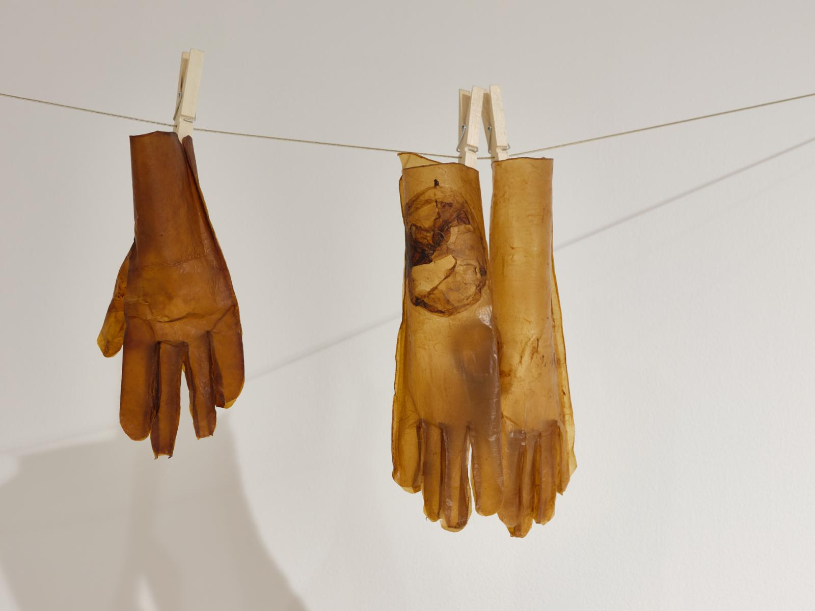 gloves made of cellulose hanging on a laundry-line