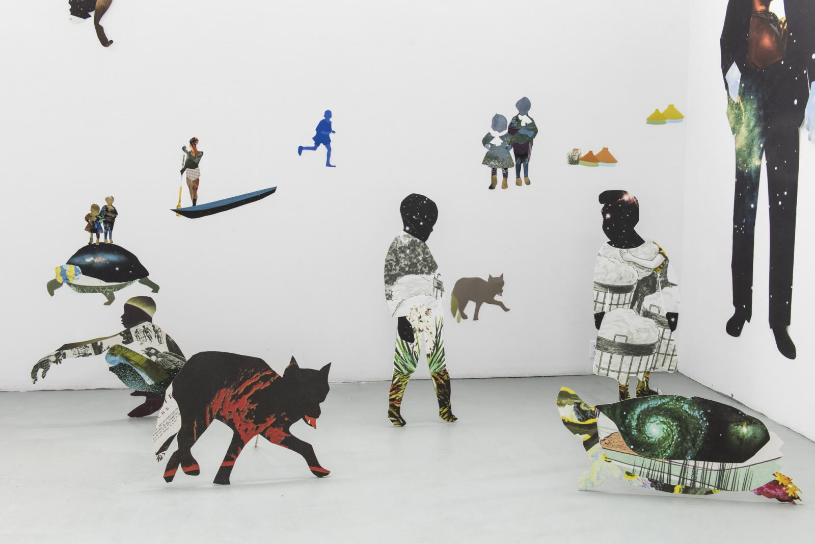 Installation of collaged work on the wall and extending into the space as 2D sculptures, featuring human and animal figures.