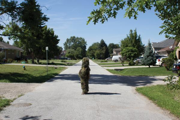 Un-camouflaging #12 (Forms of Awareness: Ghillie Suit). Performance, Windsor, ON Photo: Bree Arbor. 2012. Courtesy of the Artist.