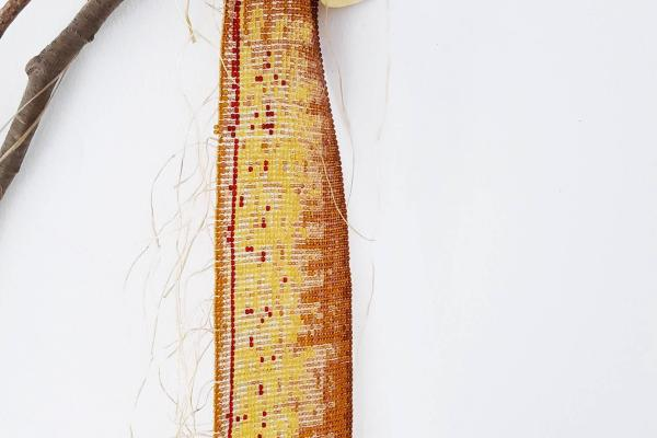 sculpture made of beads, cedar and hide