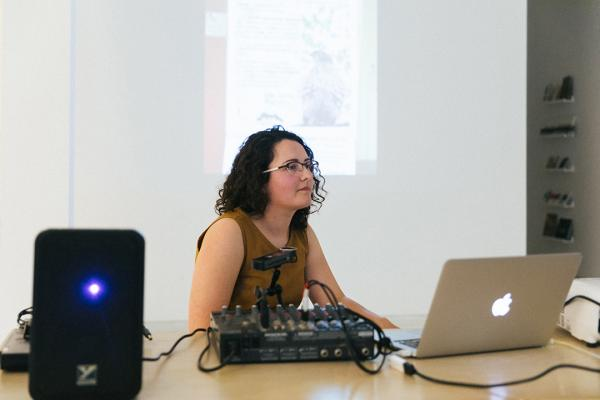 "Laurie White listening to questions during her talk, ""Polyphonic Assemblage: A Musical Toolkit for Ecological Perception,"" as part of Far Afield's project in PLOT."