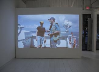 Video projection on white wall