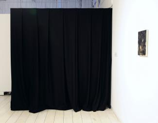 a space curtained off with a black curtain