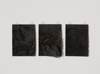three small rectangular works on black paper