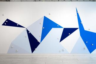 wall painting with geometric shapes in various blues