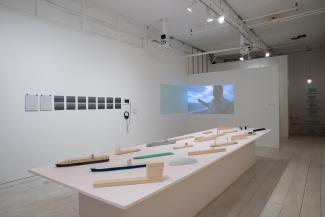 Installation views of sculptural and video objects in gallery space