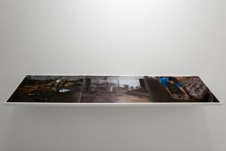 Installation views of  dark images on a white shelf