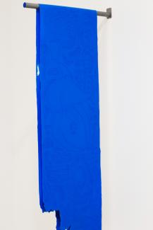 bright blue fabric hanging from a pole