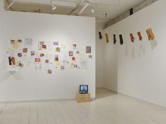 installation view of a gallery including video and installation