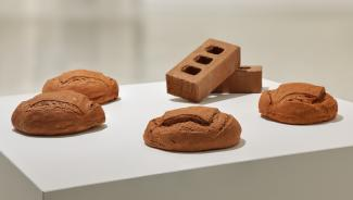 plaster sculptures of sourdough bread with bricks