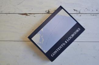 "image of cardboard box which reads ""contents: 8 logbooks"""